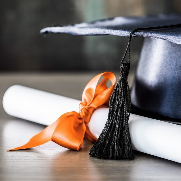 Graduation-hat-and-diploma-on-table-855246888_1920
